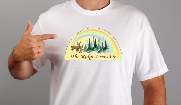 T-shirt with a rainbow and wildlife. Shirt says The Ridge Lives On.